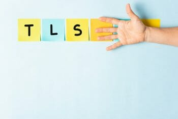 TLS transport layer security concept. Collection of different colored sticky note papers with curled corner, open palm hand hidden three notes and showing three notes.
